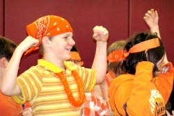 10-Orange-students-showing-muscles-edited